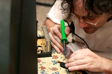 close up of a  Man repairing an old Tv photo