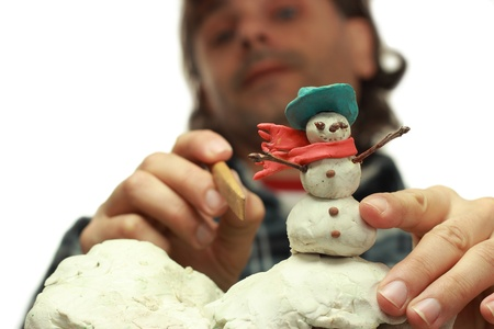 animator: traditional clay animator at work on snowman miniature Stock Photo