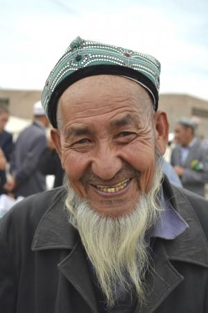 KASHGAR - JUN 20  senior Uyghur ethnicity man at  Zhongxiya Shichang  bazaar, popular animal market in Kashgar it attracts villagers, nomads and tourists on  june 20, 2011 in Kashgar, China Editöryel