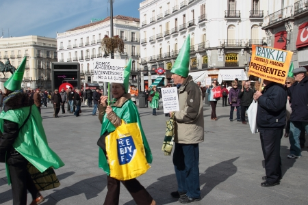 indignados: Customers of Bankia at a noisy demonstration in Puerta del Sol Square in Madrid, Spain, on Sunday March 2, 2013. Protest was focused on products known as Preferentes that were sold by Spain?s nationalised lenders, the largest being Bankia, only to see the Editorial