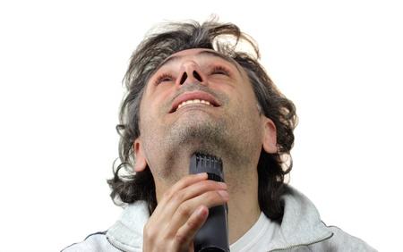 electric shaver: Uomo felice con rasoio elettrico
