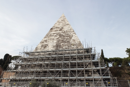 restoring: The Pyramid of Cestius during restoring works  in Rome, Italy