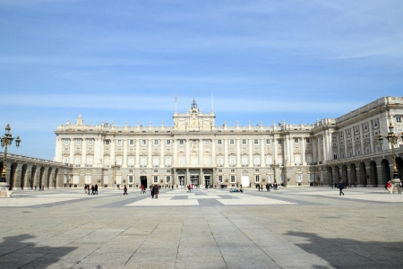state owned: Madrid, Spain - March 02, 2012: Tourists visiting the Madrid Royal Palace (Palacio Real). Its the official residence of the Spanish Royal Family. The palace is owned by the Spanish State and administered by the Patrimonio Nacional, a public agency of the