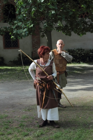 POMBIA, ITALY - JUNE 1  Medieval female archer and armoured man  at the  gli Archi di Arduino  event on June 1, 2013 in Pombia, Italy