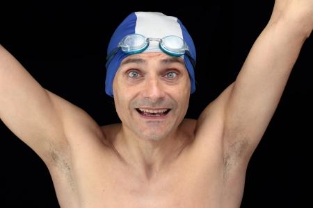 smiling swimmer over black background