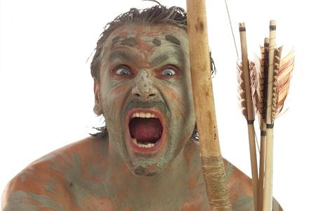 feroz: o homem primitivo que faz express�es faciais ferozes Banco de Imagens