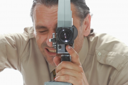 filmmaker: retro film-maker with vintage super 8 camera Stock Photo