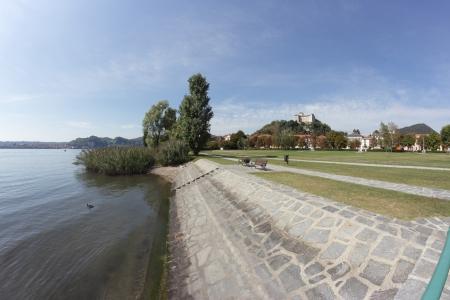 arona: fish-eye view of Angera Promenade along  Maggiore Lake, Italy Stock Photo