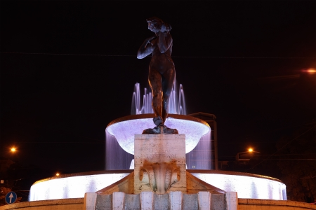 delimit: MODENA, ITALY - OCTOBER 10: Due fiumi Fountain by Giuseppe Graziosi at night on October 10, 2013 in Modena, Italy. fountain built as a tribute to the Secchia and Panaro rivers which delimit the province