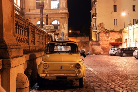 vintage car in a Roman street at night