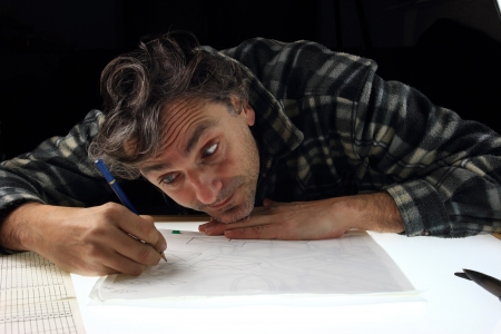 animator: worker of the cartoon animation industry on lightbox Stock Photo
