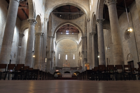 aisles: AREZZO, ITALY - JANUARY  12: the tall  interior of Santa Maria della Pieve on January 12, 2014 in Arezzo, Italy. Built in 10th early century has a nave and two aisles, divided by longitudinal ogival arches