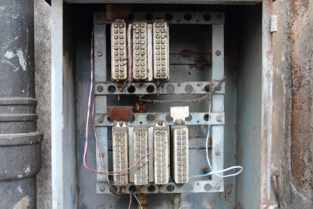 vintage relays control power circuits in old electrical panel Stock Photo