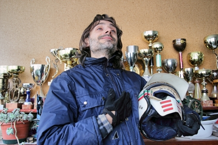 Pilot pose with helmet over a victory cup background photo
