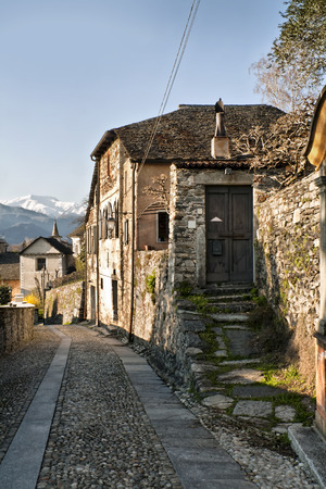 turistic: a typical street in Orta, small turistic town in Piedmont, Italy Stock Photo