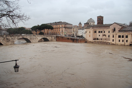 swamped: The rising level of the River Tiber near Isola Tiberina, Italy is swamped by torrential rain.