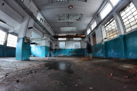 ghost workers in abandoned factory