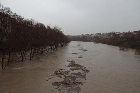 The Tiber river flooding near the Fabricio bridge also known as Ponte dei Quattro Capi. Stock Photo