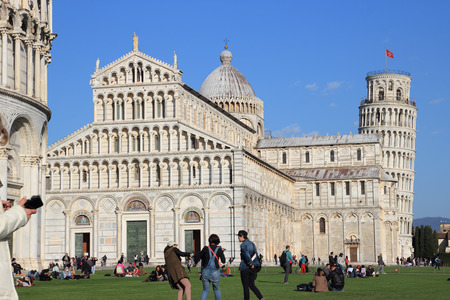 PISA, ITALY - March 07, 2014  Tourists visit Miracles square, Piazza dei miracoli in Pisa, Italy   This is one of the main centers for medieval art in the world