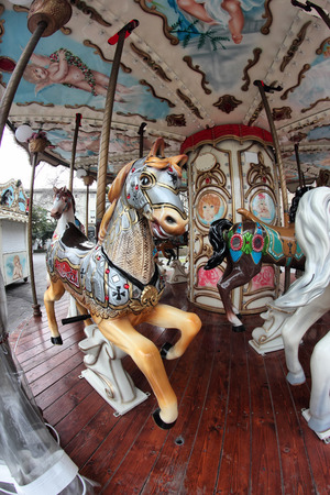 amusment: vintage carousel in a fish-eye view