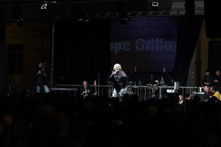 martiri: NOVARA, ITALY - MAY 14, 2014: Former comedian and Five Stars Movement leader Beppe Grillo speaks at a party rally in Martiri square Editorial