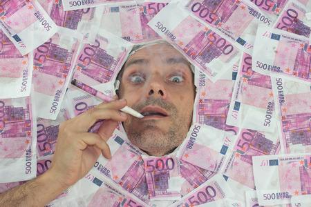 mister: Mister Euro smoking a 500 euro notes Stock Photo