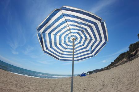 beach umbrella in a fish-eye view