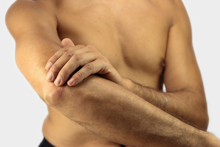 affected: man affected by Tennis elbow or lateral epicondylitis