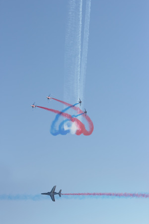 ROME, ITALY - JUNE 28, 2014:  Patrouille de France make their performance at the Rome International Air Show. Event held in Ostia beach