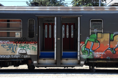 AREZZO, ITALY - JULY 16, 2014:  Graffiti Vandalism over trains in the Sansepolcro railway station