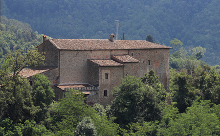 quirico: the Fortress of Vernio, dominates the towns of San Quirico and Sasseta in Tuscany, Italy Editorial