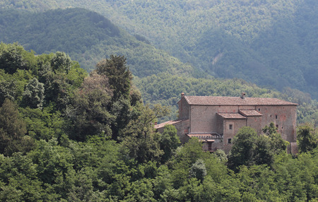 san quirico: the Fortress of Vernio, dominates the towns of San Quirico and Sasseta in Tuscany, Italy Editorial