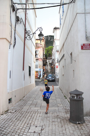 felice: LATINA, ITALY - AUGUST 9, 2014: Children play soccer in the old town of San Felice Circeo