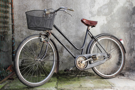 old bicycle: old bicycle over a shabby background Stock Photo