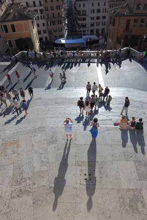 monti: ROME, ITALY - SEPTEMBER 13, 2014:  People enjoy  the sunny day on the Spanish steps at Trinita dei Monti