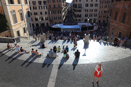 spanish steps: ROME, ITALY - SEPTEMBER 13, 2014:  People enjoy  the sunny day on the Spanish steps at Trinita dei Monti
