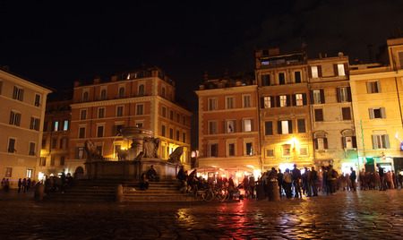 lively: ROME, ITALY - NOVEMBER 8, 2014: evening  in Piazza di Santa Maria in Trastevere. Romans and tourists flock to Trastevere to enjoy its lively nightlife