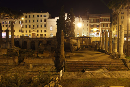 sacra: area sacra Roman ancient ruins in Largo di Torre Argentina square by Night, Rome, Italy