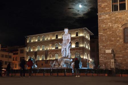 signoria square: FLORENCE, ITALY - DECEMBER 7, 2014: Fountain of Neptune at night in Piazza della Signoria square. The masterpiece by sculptor Bartolomeo Ammannati was commissioned in 1565
