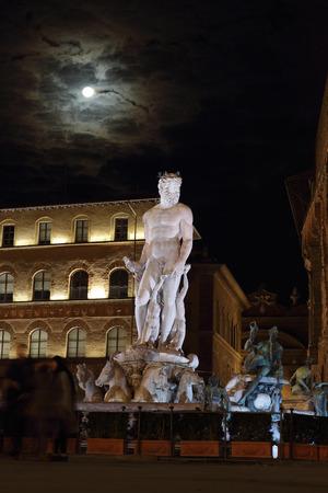 commissioned: FLORENCE, ITALY - DECEMBER 7, 2014: Fountain of Neptune at night in Piazza della Signoria square. The fountain was commissioned in 1565 and is a masterpiece of the sculptor Bartolomeo Ammannati.
