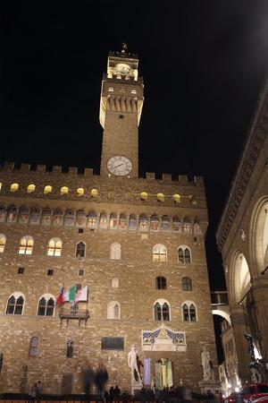 signoria square: FLORENCE, ITALY - DECEMBER 7, 2014: David statue at night in Piazza della Signoria square. The masterpiece by sculptor Michelangelo under Palazzo Vecchio