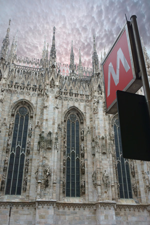 Metro sign under the Duomo Cathedral in Milan, Italy