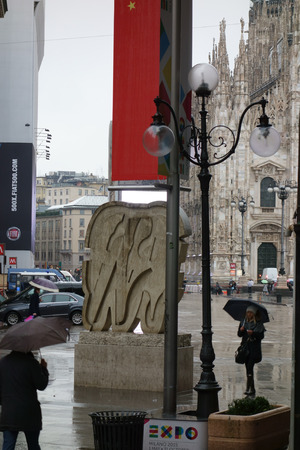 exposed: MILAN, ITALY - FEBRUARY 6, 2015: International Exhibition EXPO 2015 banners exposed in Duomo square Editorial