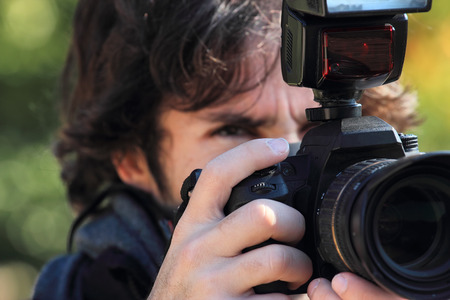 reflex camera: photographer with reflex camera and flash close up Stock Photo