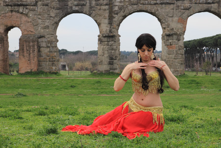 paramour: beautiful belly dancer under the Roman aqueduct