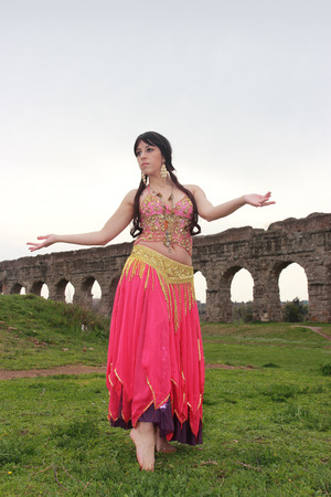 waterworks: belly dancer with ancient Roman aqueducts ruins