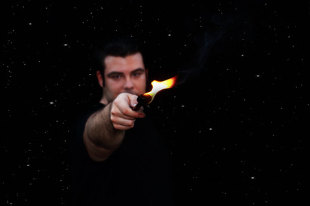 eater: out of focus fire eater over a starry night background