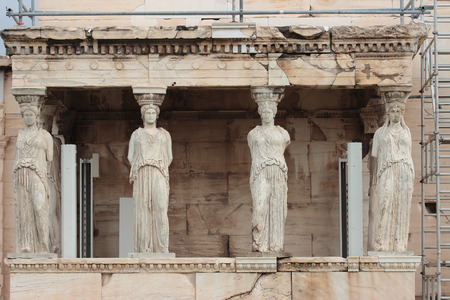 statues of Karyatides on Porch of the Acropolis hill, Athens, Greece