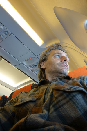 jetsetter: Man on airplane looking outside