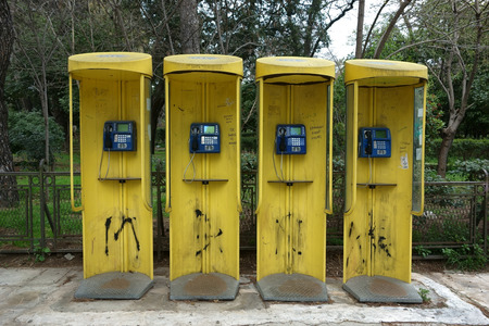 phonebox: ATHENS, GREECE - MARCH 23, 2015: four telephone boxes, OTE is the Hellenic Telecommunications Organization